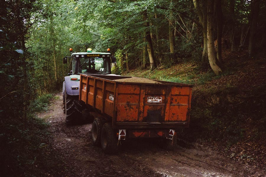 Tractor with grain in woods