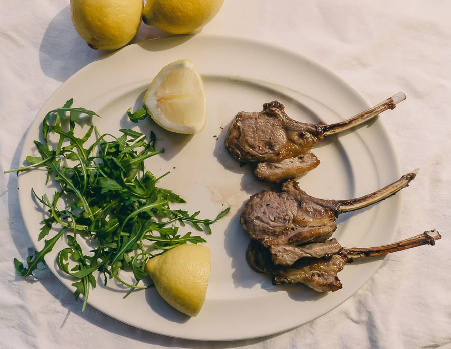 Grilled Lamb Cutlets with lemon and rocket garnish