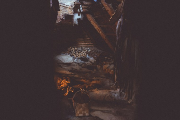 The inside of a stone age wooden house in Kierikki, Finland