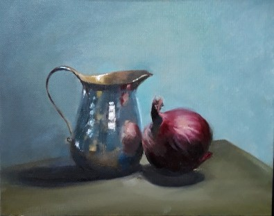 Silver jug and red onion