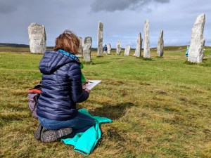 Nicky Sanderson sketching standing stones at Calanais