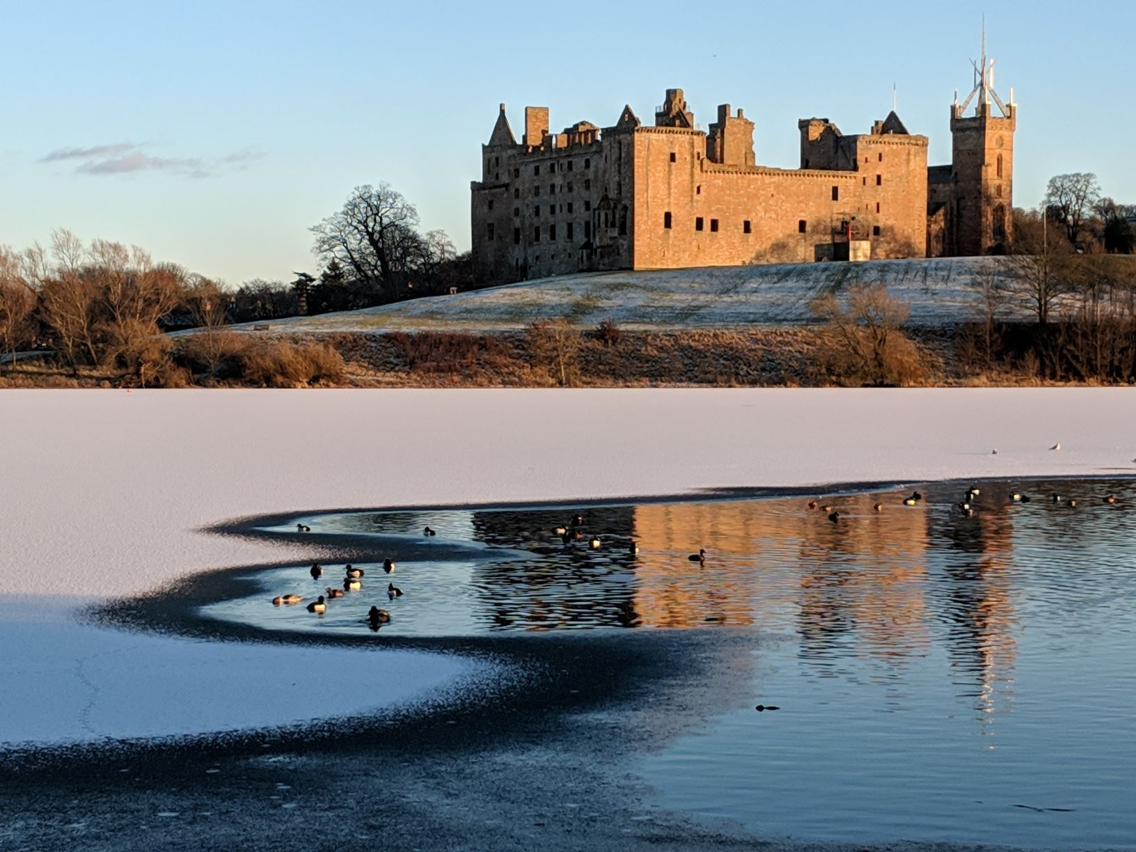 Linlithgow loch frozen with snow