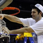 Wildcats' Harrellson clips the net after his team's victory over the Tar Heels in their NCAA East Regional game in Newark