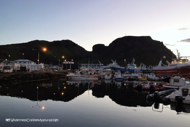 Translucent midnight dusk at Heimaey harbour, Vestmannaeyjar, Iceland