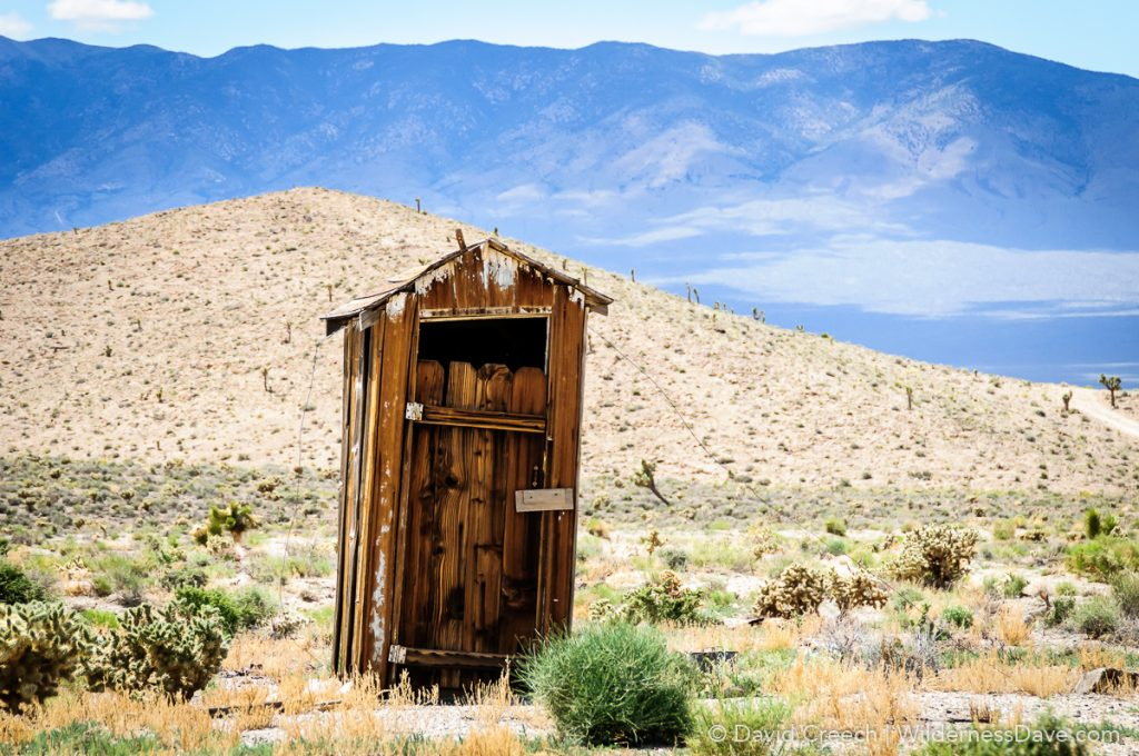 desert scene with old outhouse in Gold Point
