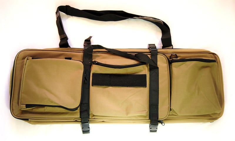 brown rifle or bow bag with pockets