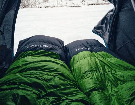 green and navy blue sleeping bag