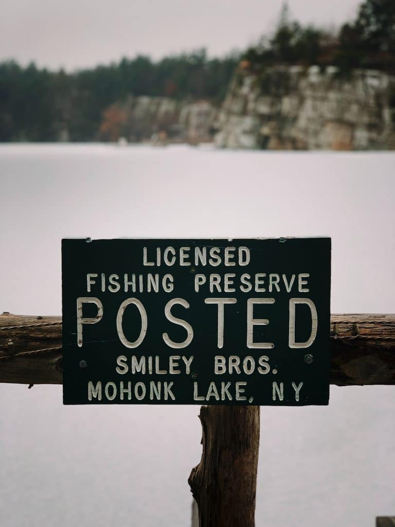 licensed fishing preserve signage on a lake