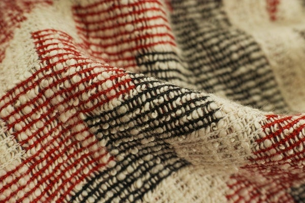 white-black-and-red-textile