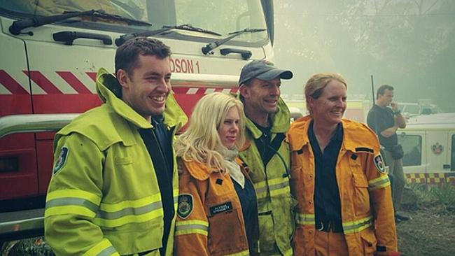 Prime Minister Tony Abbott with fellow firefighters