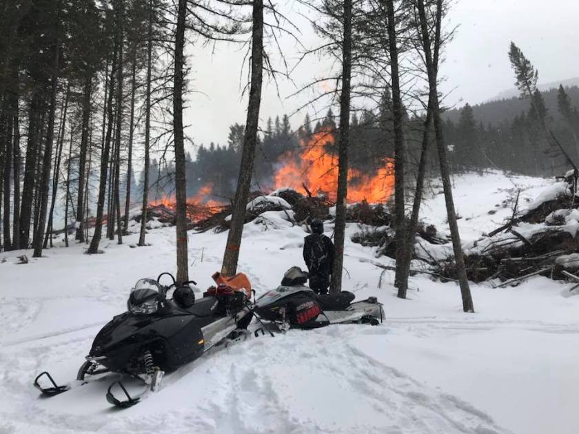 pile burning Lewis Clark National Forest snow