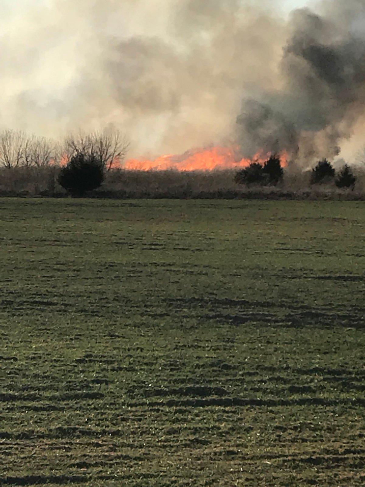 Wind-driven wildfires race through Kansas Wednesday