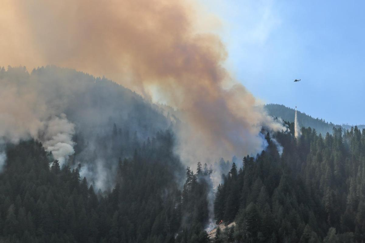 K-MAX helicopter drops water Terwilliger Fire