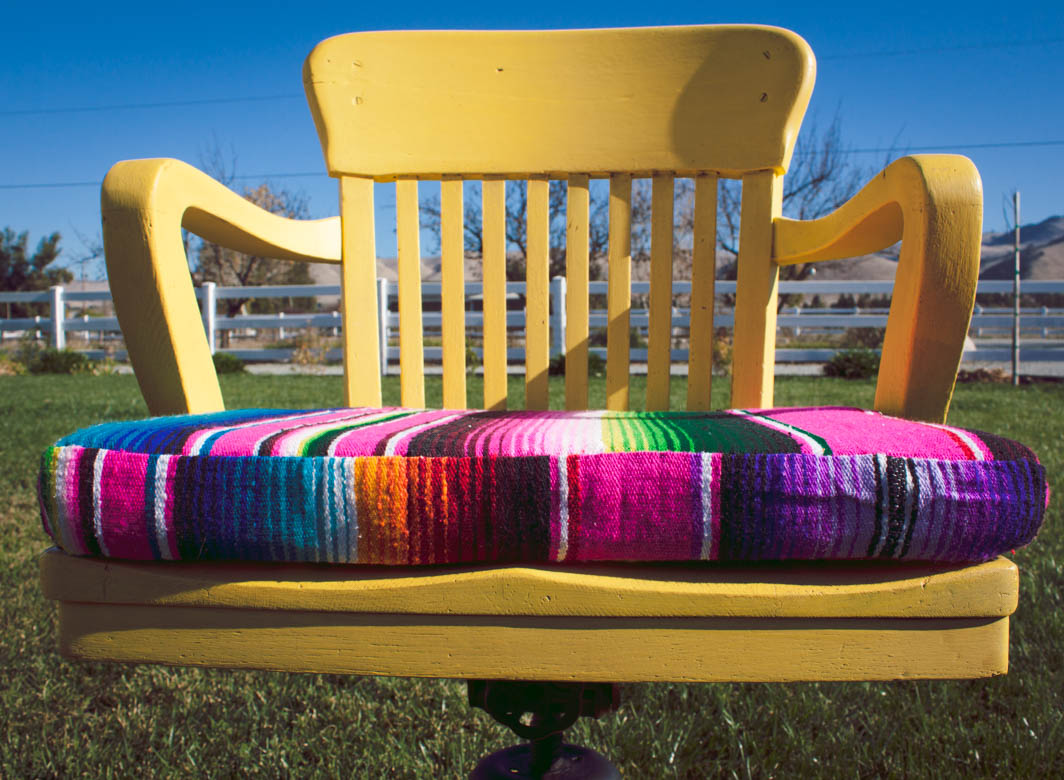 yellow chair with serape pad