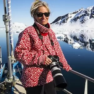 A photographer on a sailboat in Svalbard