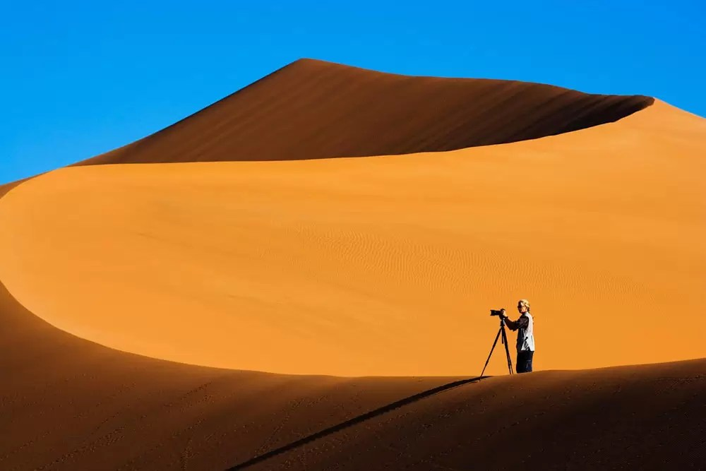 Photographer on sand dune