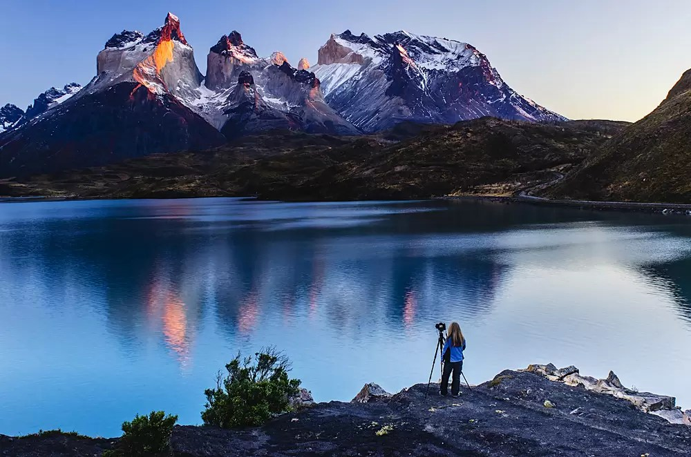 A photographer photographing the peaks and spires of Torres del Paine