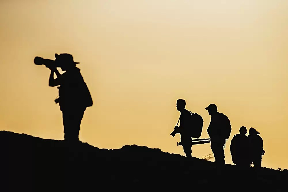 Silhouette of photographers and tourists in the Galapagos