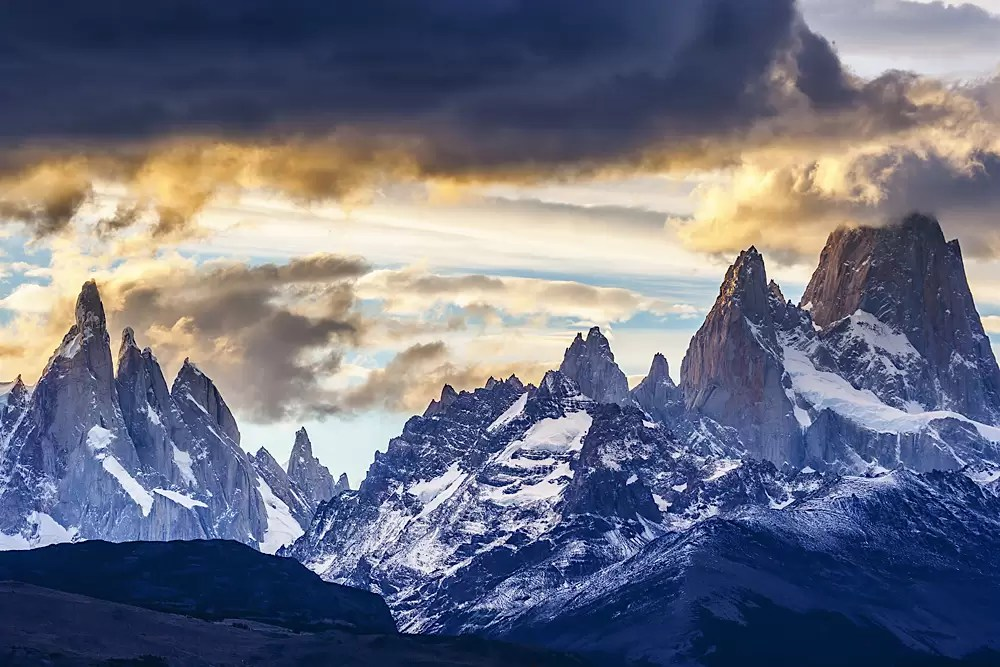 Mt Fitzroy Range and Cerro Torre under clouds at dawn