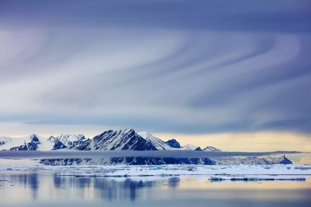 Svalbard, NE corner, package and reflection of mountains in ocean in June