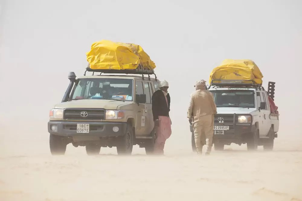 Vehicles in sandstorm, Chad