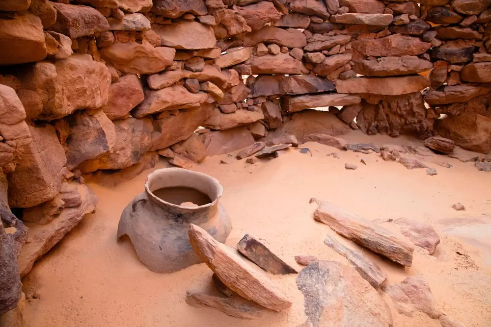 Old stone house and clay pot of early inhabitants