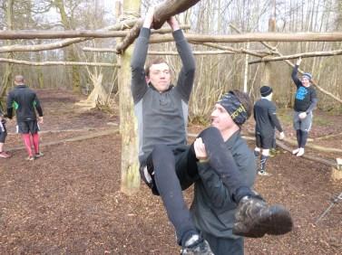 Hang tough leg raise assisted