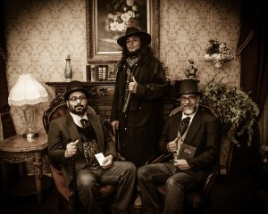 3 gentleman dressed up for an old time photo in Pigeon Forge TN