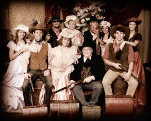 An Old West themed photo shoot with a large family.