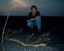 """Beata and a king brown snake. Before the arrival of the cane toads """"kingis"""" were never common but since 2006 we have not seen one of these huge elapids."""