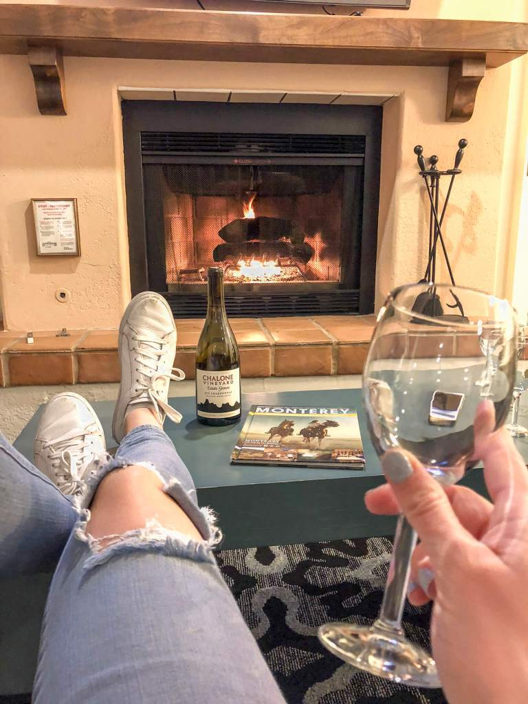 Wine glass in hand, overlooking a roaring fire in my hotel room in Monterey, California.