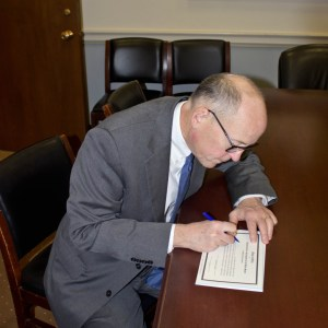 Signing my oath of office for the new session of Congress.