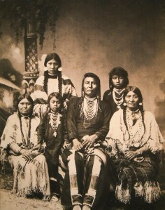"""Description by museum: This photograph is historically significant and has great human interest as well. It may be the only extant copy in existence of F. M. Sargent's cabinet card of Nez Perce Chief Joseph and his family in Leavenworth where they were exiled from 1877 to 1885. Chief and his band of Nez Perce lived peacefully in the Wallowa Valley of Eastern Oregon until 1877 when the U.S. government decided to move the band to a small reservation in Idaho. When General O.O. Howard threatened a cavalry attack, a few dissatisfied warriors raided a settlement and killed several whites. Fearing retaliation, Joseph fled with his band of 700 men, women and children in a retreat towards Canada that covered 1400 miles. They finally gave up 40 miles from the Canadian border where Joseph uttered the famous words """"From where the sun now stands, I will fight no more forever."""""""
