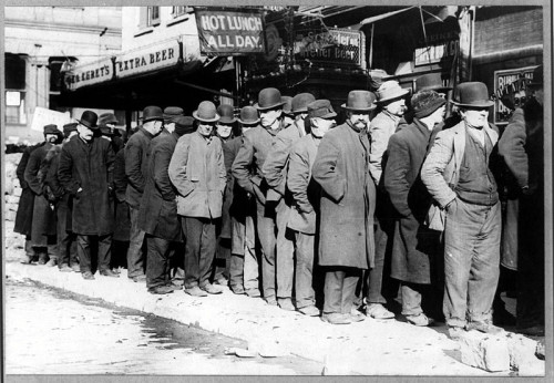 Bread line in New York City, circa 1910. [Public Domain]