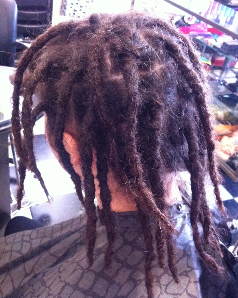 brown midlength dreads after