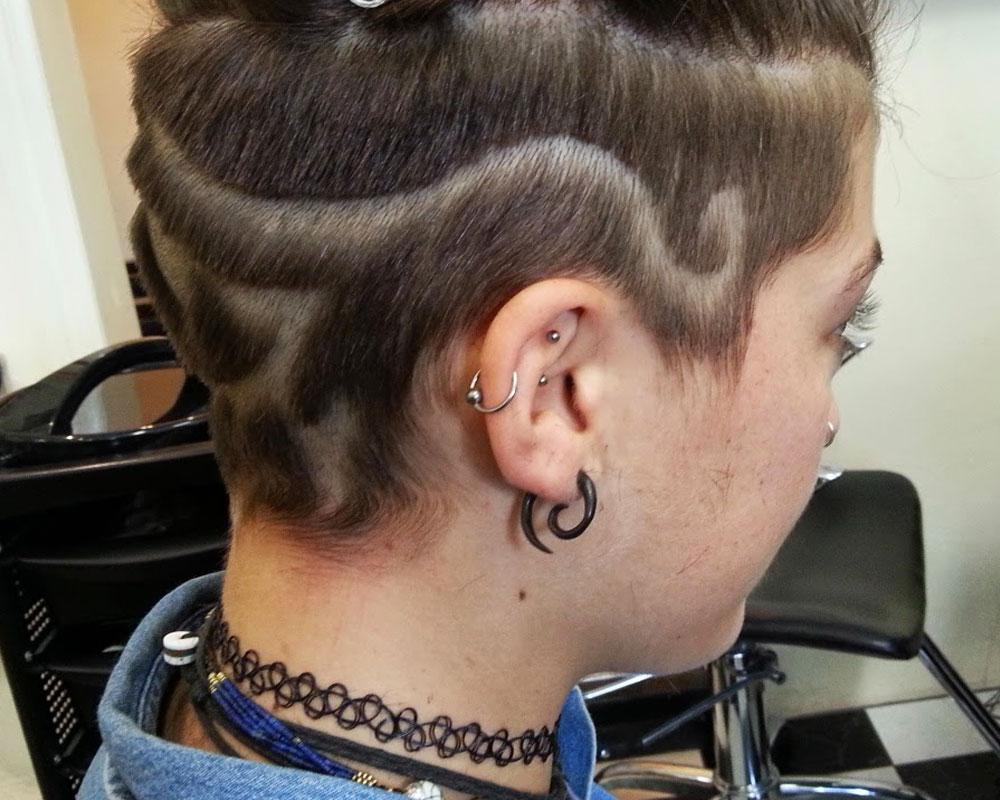 egytian eye swirls hair tattoo 1