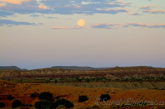 The sun rises as a full moon sets on Lower Sykes, August 2012
