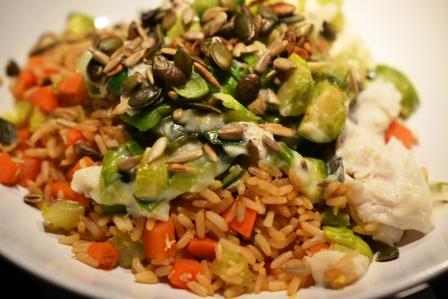 Responsibly caught hake, brown rice, organic coconut, leeks, garlic and brussels sprouts from the garden,toasted seeds.