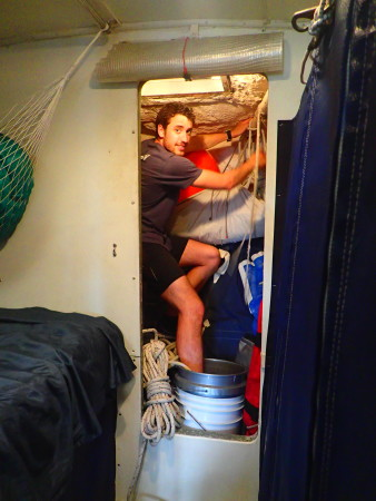 Cramming spare gear into the sail locker