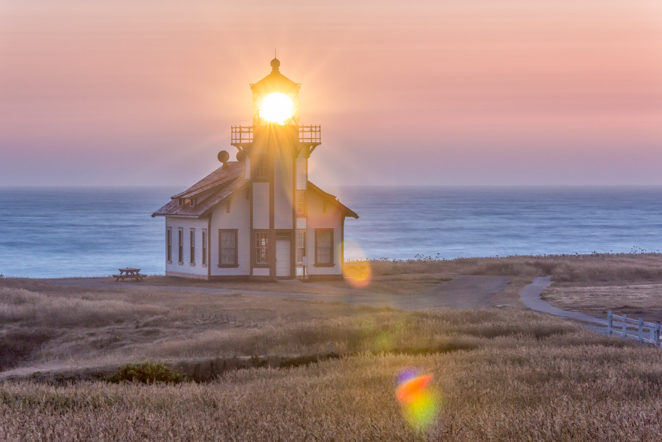 Sunset photo of a lighthouse on the California coast, Point Cabrillo Lighthouse