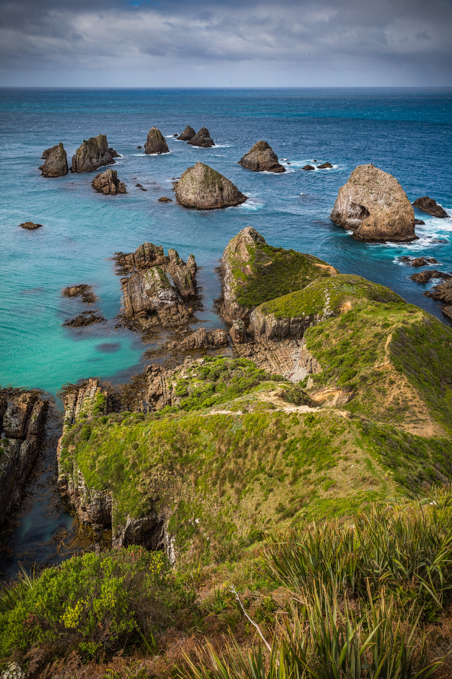 Ocean view and jagged rocks from the Nugget Point Lighthouse trail, South Island, New Zealand