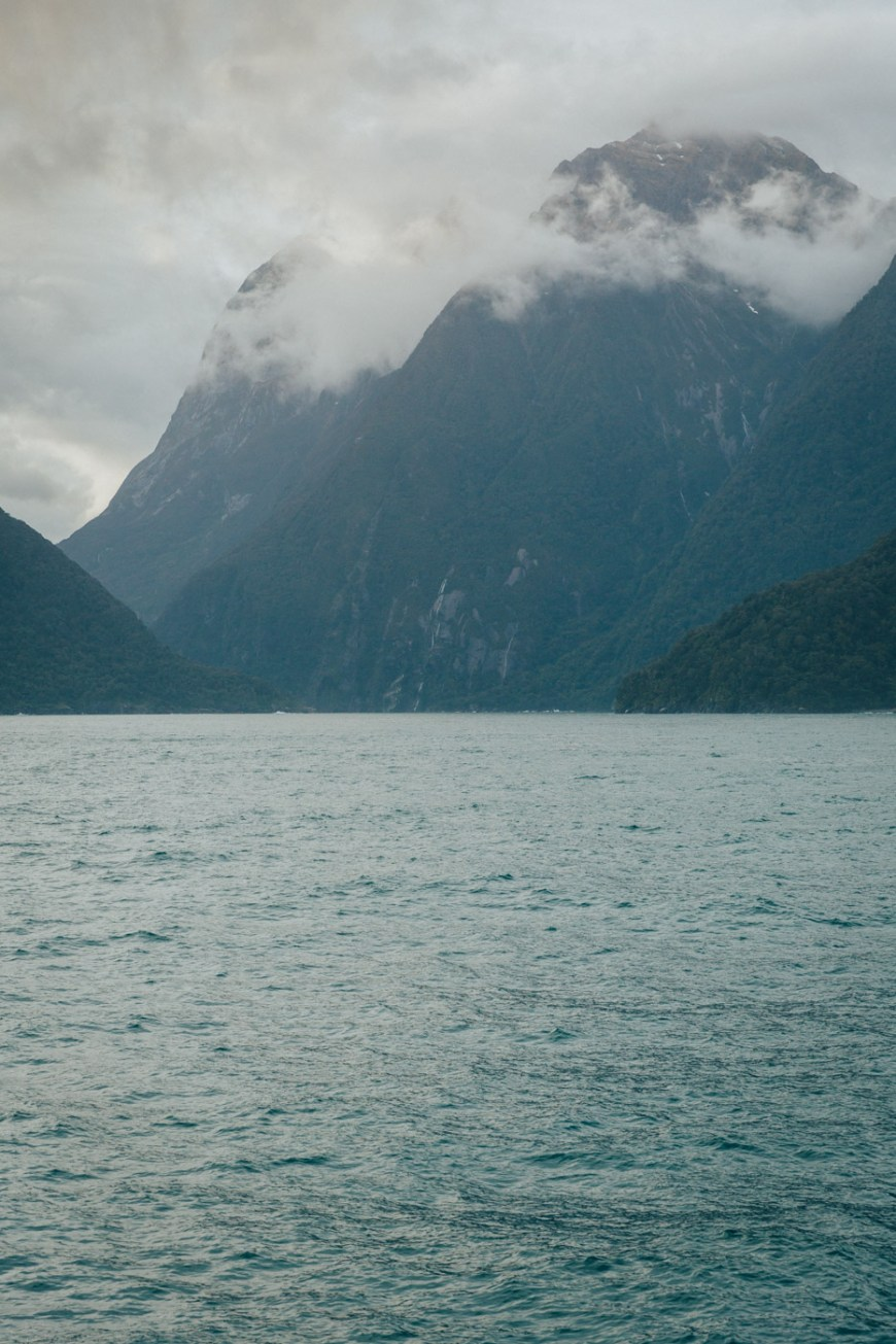 Breaking clouds in the misty morning on our Milford Sound cruise.