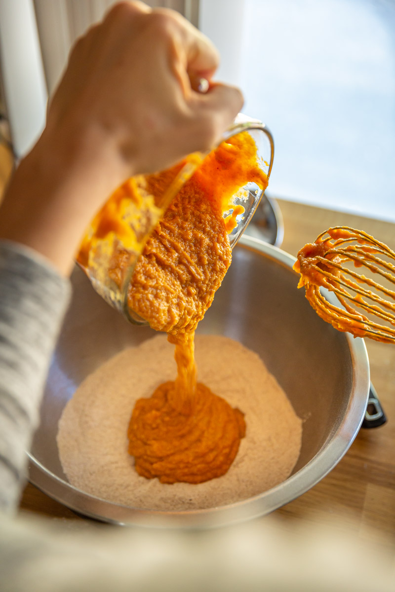 Mixing the batter for a Whole Wheat Pumpkin Bread recipe