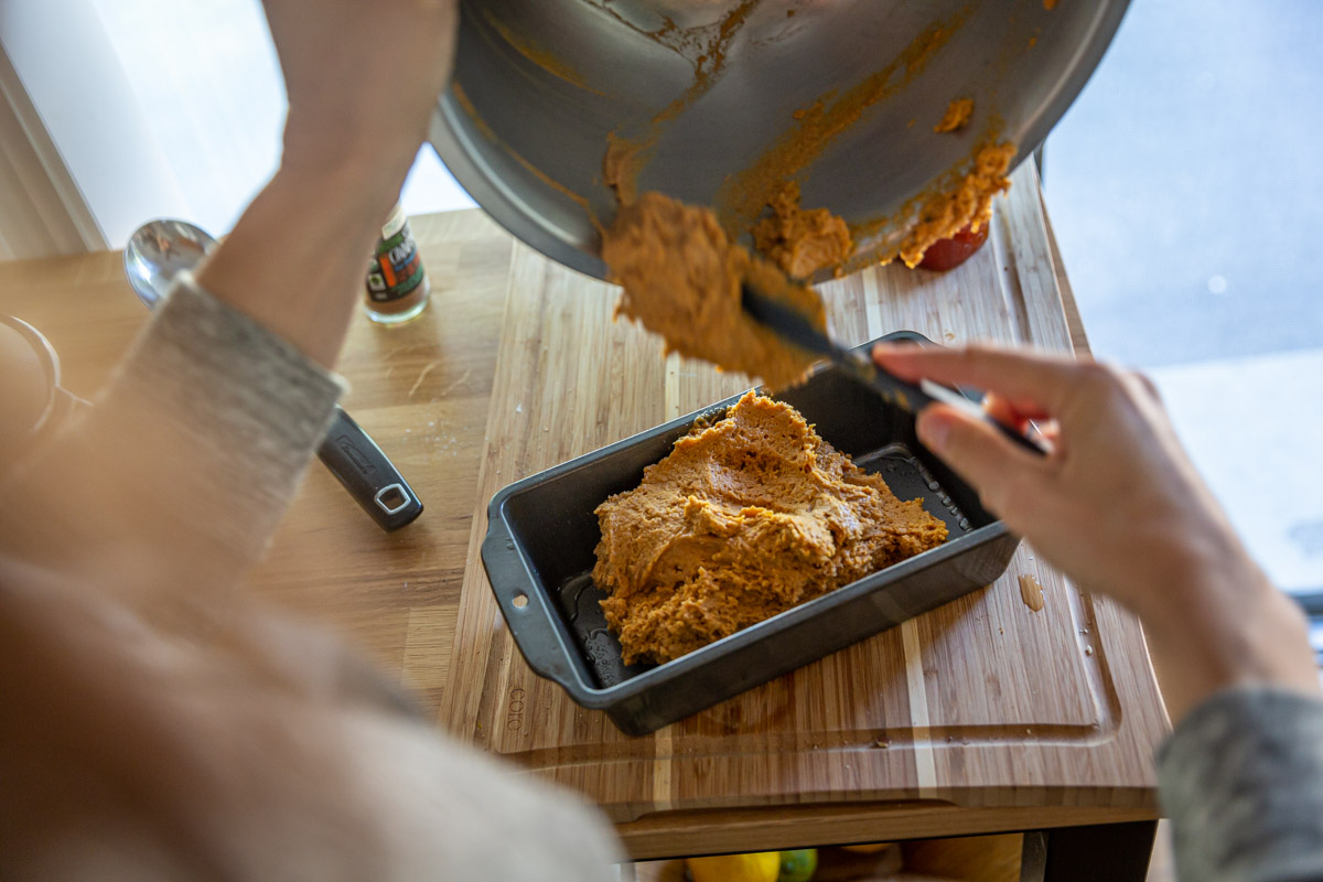 Dump the batter into a freshly oiled baking pan.