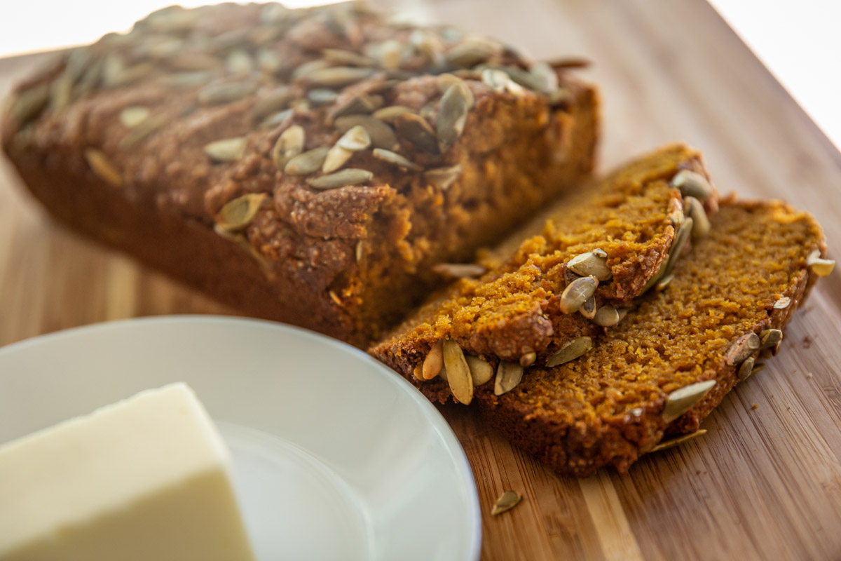 A fresh loaf of Whole Wheat Pumpkin Bread is ready to eat.