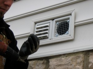 Securing a bathroom exhaust vent to prevent bird entry. Photo by Stephen M. Vantassel.