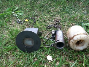 Encapsulated foot traps (left to right), Coon Cuffs, Lil' Grizz, and The Egg Trap. Photo by Stephen M. Vantassel.