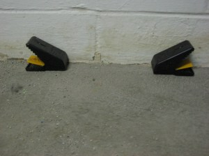 Clamshell-style traps positioned properly against the wall. Photo by Stephen M. Vantassel.