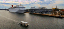 The 42ft Osprey is easily dwarfed by a Cruise ship on the Working Water Front Tour
