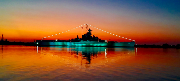 The USS Alabama at sunset in Mobile Bay on The Battleship at Sunset Kayak Experience from WildNative Tours